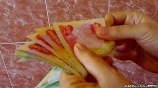 Deleting the Zeros A6386-dinars
